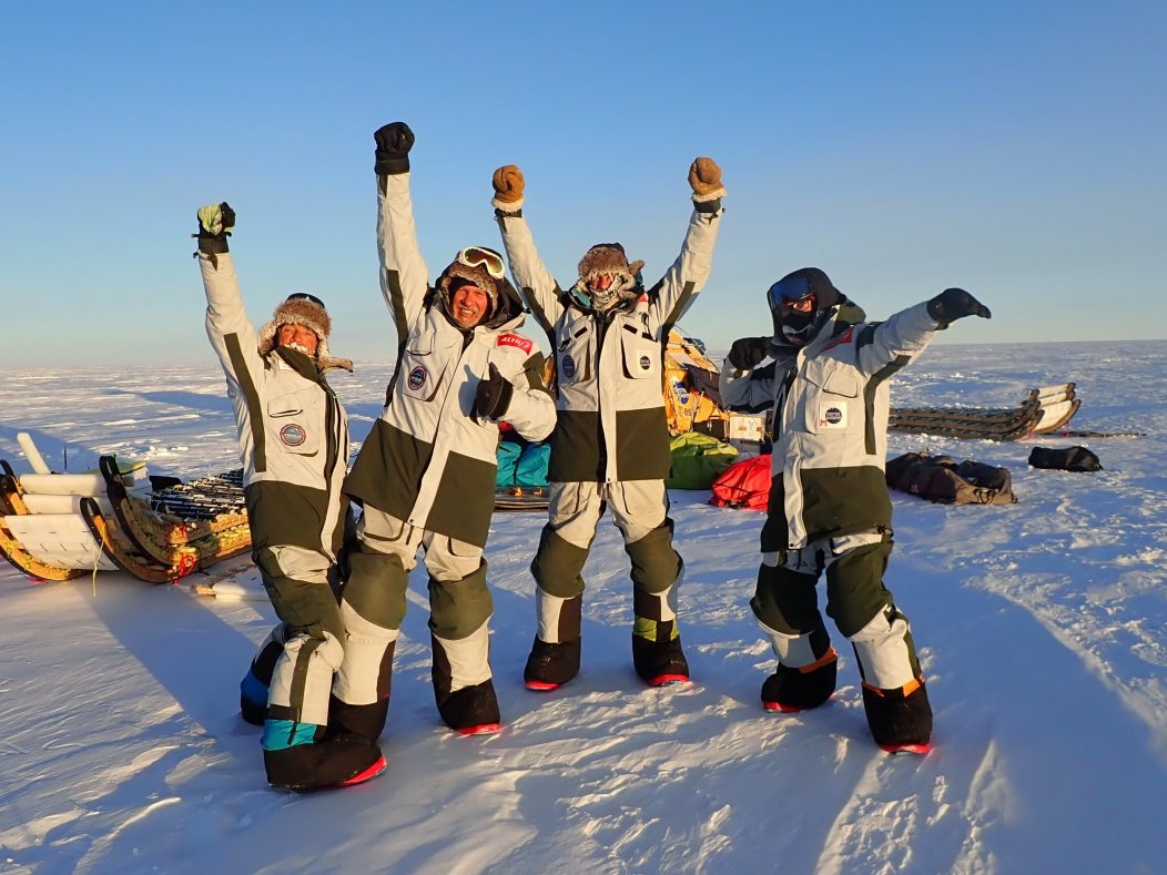 The WindSled team celebrate completing the 2,500 km expedition